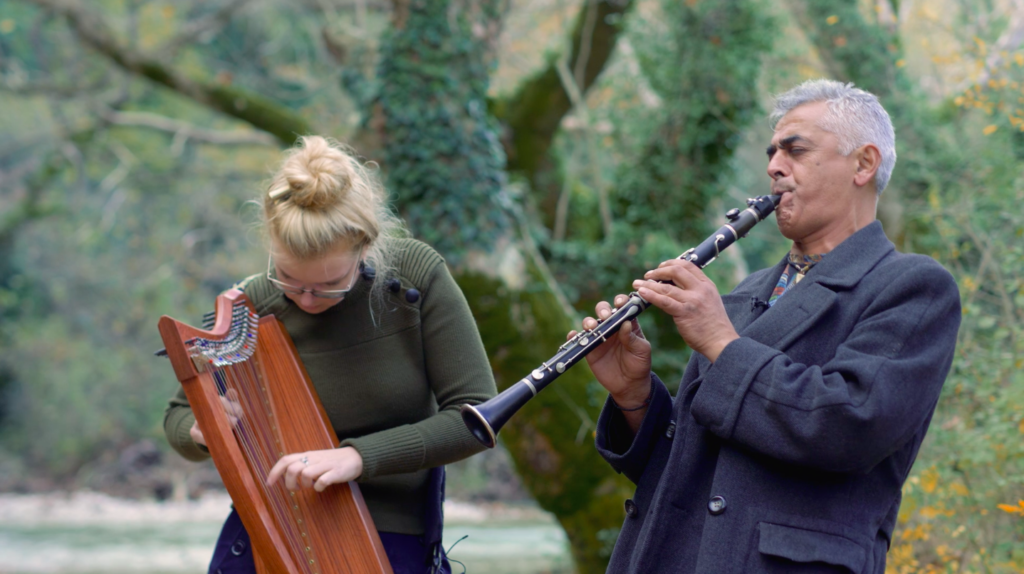 Two musicians playing their instruments outside