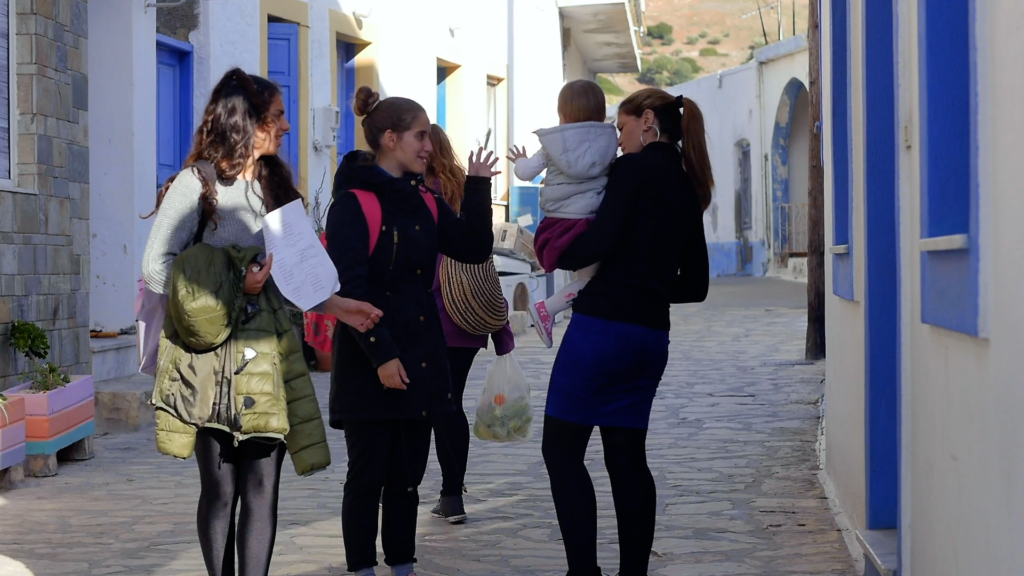 A group of young people talking in the streets of Greece