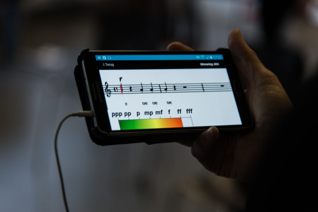 An image of a smartphone with musical notes.
