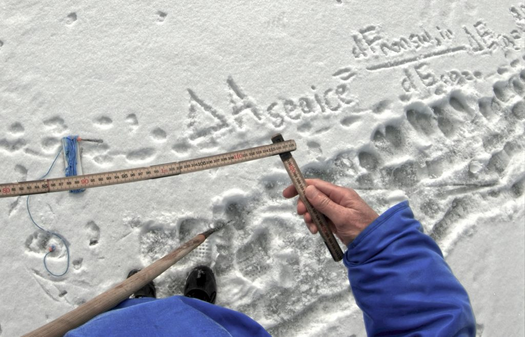 Sea ice loss formula written in snow